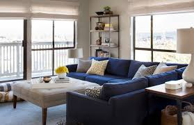 blue sofas living room: yellow accents  niche interiors yellow accents
