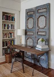 chic home office decor:  vintage wooden doors bring shabby chic charm to this home workspace design lewis giannoulias
