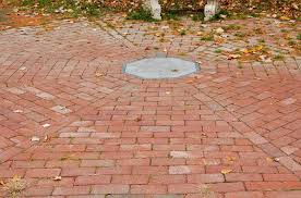 create brick patio image of a circular brick patio with a medallion inlay in the center