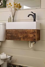 country themed reclaimed wood bathroom storage: reclaimed  floating vanity made from reclaimed wood girl meets carpenter featured on remodelaholic