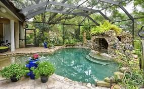 covered patio freedom properties: amazing outdoor spaces by top designers fireplaces backyards and movie nights