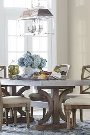 room table displays coaster set driftwood: our lakeview rectangle dining table has a concrete top double pedestal base and a driftwood