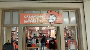 signs banners precision sign design page  osu wall mural osu tulsa store front sign