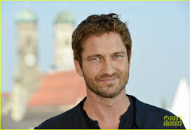 About this photo set: Gerard Butler flashes a smile as he poses for photographs at the photo call for his flick Olympus Has Fallen held at the Hotel ... - gerard-butler-olympus-has-fallen-munich-photo-call-05