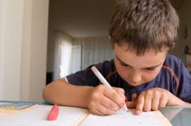 young student working on homework