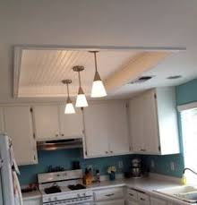 kitchen fluorescent lighting. gorgeous kitchen fluorescent light box remodel with wood beadboard ceiling panels in white paint finishes also stainless steel pendant lighting fixtures of l
