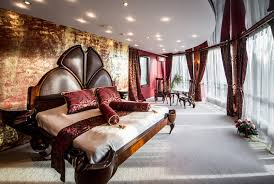 big master bedrooms couch bedroom fireplace: large master bedroom in luxury house with semi circle windows