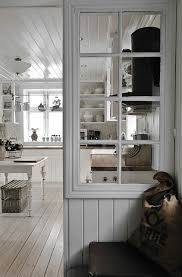 white kitchen windowed partition wall: old window to a new partition wallthen a wood as required by hoa in antiquityscreen door on patio to keep paris in and safeask joe as it needs to