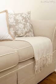 cream couch living room ideas: acolor beige tan cream a beige tan cream sofa couch throw pillows and throw in living room