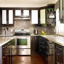 black and stainless kitchen kitchen with black cabinets and stainless steel appliances