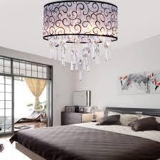 modern bedroom lighting ceiling using drum shade chandelier with faceted teardrop crystal beads above quilted bed bedroom chandelier lighting