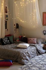 how you can use string lights to make your bedroom look dreamy above bed lighting
