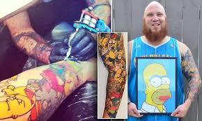 Simpsons fan Lee Weir breaks world record after having 41 <b>Homer</b> ...