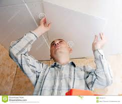 Ceiling Tiles For Kitchen Man Glues Ceiling Tile At Kitchen Stock Image Image 25342171