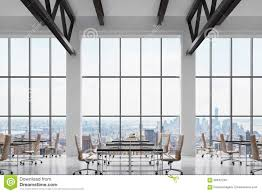 modern workplaces in a modern bright clean interior of a loft style office huge windows bright office