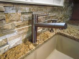backsplash cobblestone material cozy kitchen