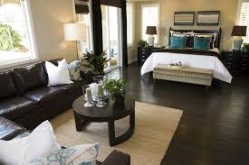 bedroom with dark brown hard flooring and furniture contrasting with white doorway and windows bedroom ideas with dark furniture