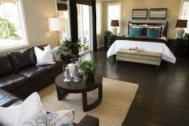 bedroom with dark brown hard flooring and furniture contrasting with white doorway and windows bedroom design ideas dark