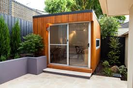 one corner entirely consisting of glass the cooba by inoutside is a prefab modern room thats ready to be dropped into your backyard as a studio backyard office prefab