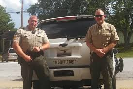 Why officers are putting '<b>In God We Trust</b>' bumper stickers on their ...