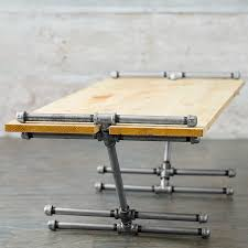 attach the legs to the top black iron pipe table