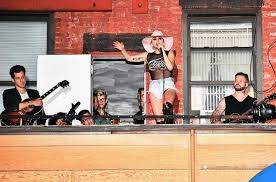 lady gaga s joanne vote for your favorite track billboard lady gaga surprises fans while on the bud light x lady gaga dive bar tour where