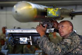 u s department of defense photo essay air force staff sgt robert olsen guides munitions into place on an f 16cm