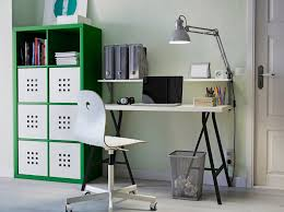 a home office with green kallax storage linnmon table in black and white and a anew office ikea storage