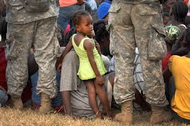 u s department of defense photo essay a little girl peers through the legs of u s army iers who form a human chain