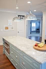 kitchen island granite top sun:  wickham gray gorgeous kitchen with industrial pendants over blue kitchen island with beadboard trim vermont white granite countertops and built in oven