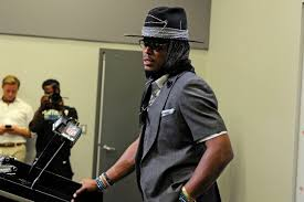 Cam Newton's outfit was flashier than his game against the Rams ...