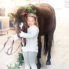 essay sharing a love of horses equestrian culture cordelia charleigh olive and coach pose together for charleigh s cookies holiday shoot photo credit woodside images jsinclair