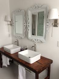 dog faces ceramic bathroom accessories shabby chic: white bathroom with vessel sinks and wood table as vanity