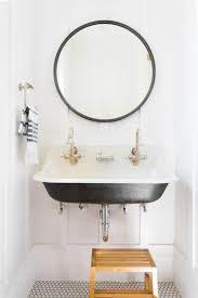 dog faces ceramic bathroom accessories shabby chic: powder bathroom with black double sink and hex floors studio mcgee