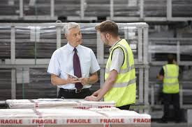 360 degree feedback the good the bad and the ugly warehouse worker and manager discussing order in engineering warehouse