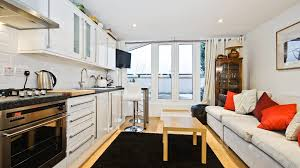 marvelous design of the kitchen and living room areas with white wall added with white sofa compact apartment furniture