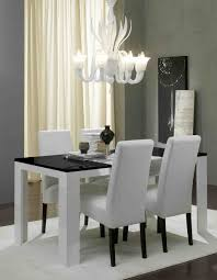 black and white dining table set: awesome design ideas of dining room chairs with white armless fabric high back and black wooden