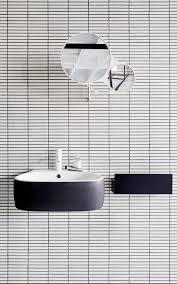 bathroom white tiles: floating sink white tile black grout round mirror