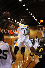 u s department of defense photo essay all navy guard seaman brandon newman flies over an army defender for two points during a