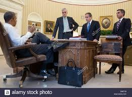 us president barack obama talks with senior advisors in the oval office of the white house barack obama oval office