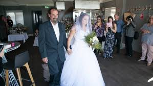 cancer battle behind them on special day newcastle herald here comes the bride sabree carter is walked down the aisle picture waterfield