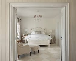 white and beige traditional bedroom with the checkered floor chandelier casual bead board beige bedroom furniture
