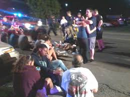 theater terror wreg com victims are tended to in the parking lot of an aurora theater where a mass