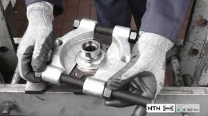 <b>Removal &</b> fitment cartridge <b>wheel bearing</b>: using a press