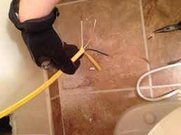 code bathroom wiring: cut the wire so that you can loop it around once when pushing the receptacle back in strip the outer layer and separate the white black and ground wires