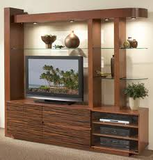 interior dazzling wall unit living room design ideas with white wall paint color and brown color wooden large home entertainment cabinets also combine with flat tv table and component shelves also gla