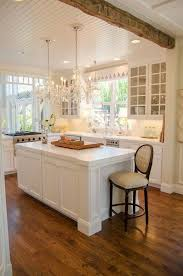 kitchen timeless white x glass wall sleek and modern appliances combined with classic beams and white marb