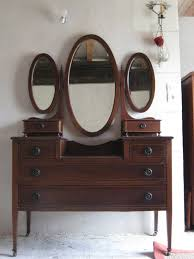 m art deco dark brown polished mahogany wood bedroom vanity with three oval mirror and short poles plus 6 drawers art deco mahogany framed office chair