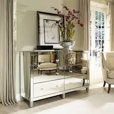 living room with mirrored furniture