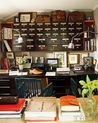 small space office cool use of a high ceiling very manly but i charming small guest room office ideas